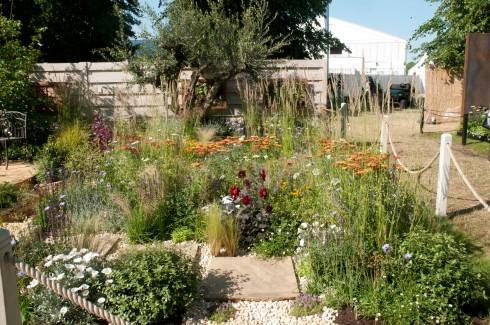 his garden into distinct areas in his four corners garden